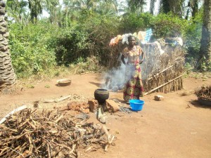 A lady preparing a meal in Africa